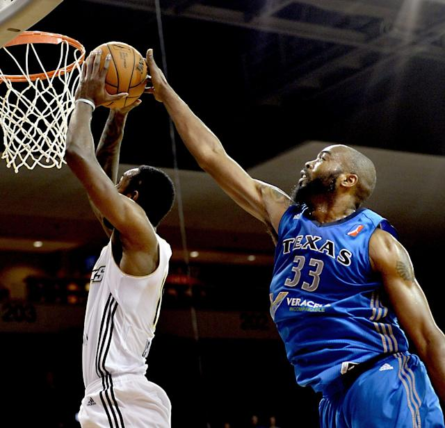 Erie Bayhawks' CJ Leslie, left, has his shot blocked by Texas Legends' Melvin Ely, right, during the second quarter of an NBA D-League basketball game in Erie, Penn., on Saturday, Dec. 21, 2013. (AP Photo/Erie Times-News, Jarid A. Barringer)