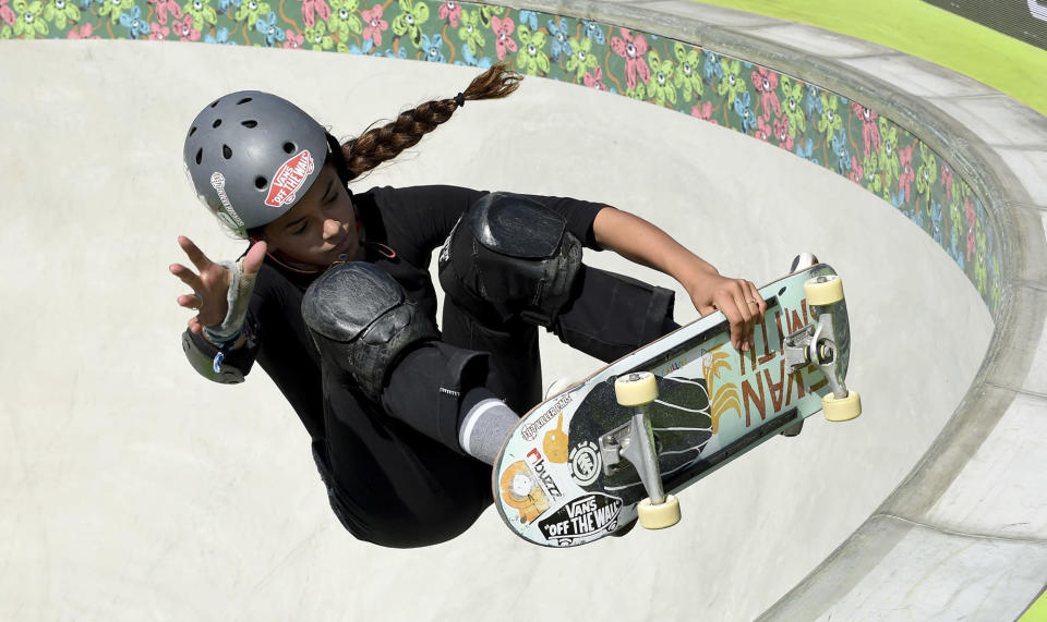 FILE - In this Thursday, June 13, 2019, file photo, Madeleine Larcheron, of France, competes in the women's park semifinals during the skateboard Dew Tour, in Long Beach, Calif. Skateboarding is one of four debut sports at the Tokyo Games, along with karate, surfing and sport climbing. (Keith Birmingham/The Orange County Register via AP, File)