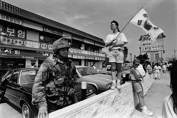 The National Guard at the Korean Pride Parade in Los Angeles on April 29, 1992 following the riots that swept the city after three of four police officers accused of the 1991 beating of Rodney King were cleared of all charges. | Ted Soqui—Corbis/Getty Images