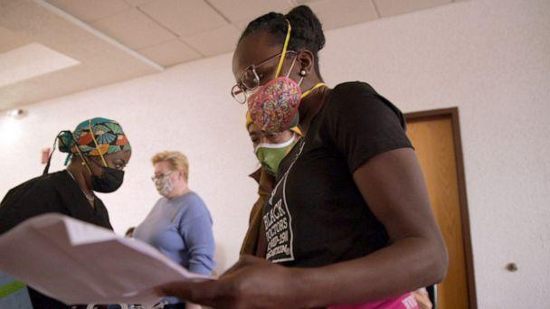 PHOTO: Dr. Ala Stanford checks in patients at her North Philadelphia vaccine clinic. (ABC News)