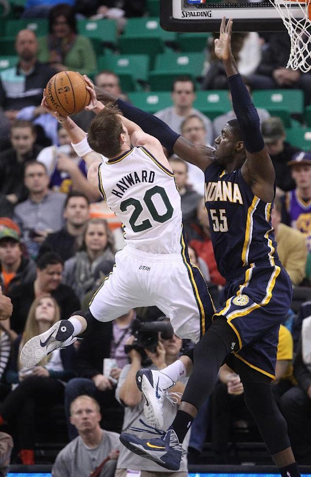 Utah Jazz's Gordon Hayward (20) shoots as Indiana Pacers' Roy Hibbert (55) defends in the first quarter during an NBA basketball game Wednesday, Dec. 4, 2013, in Salt Lake City. (AP Photo/Rick Bowmer)