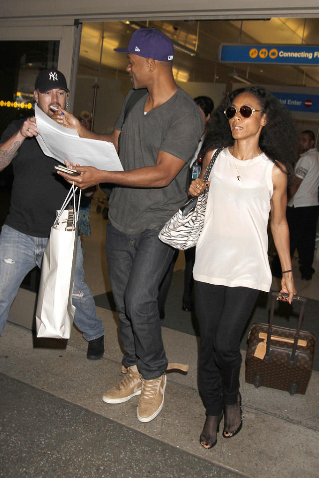 "Will Smith and his wife, Jada Pinkett Smith, were spotted making their way out of Los Angeles International Airport on Monday. We're sure they were happy to be home as Jada has been busy traveling the world raising awareness for the epidemic of human trafficking. ""love Dubai! On my way to Ethiopia,"" she tweeted last Thursday. ""Catch up with all of you when I get back. Will send pics."" (7/2/2012)"
