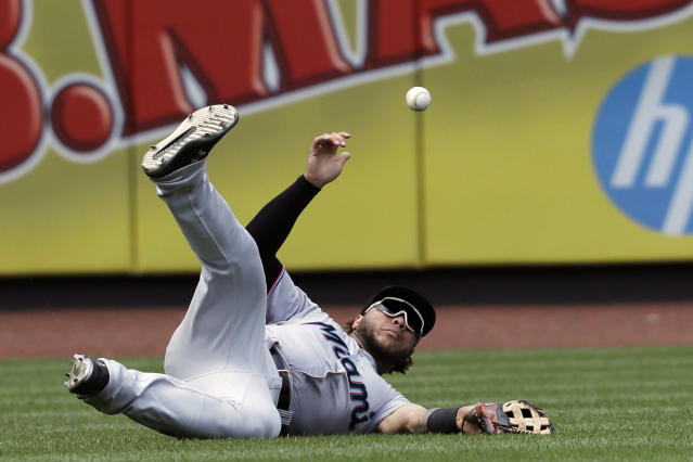 Miami Marlins left fielder Harold Ramirez can't reach a fly ball single by New York Mets' Wilson Ramos in the sixth inning of a baseball game, Wednesday, Aug. 7, 2019, in New York. (AP Photo/Mark Lennihan)