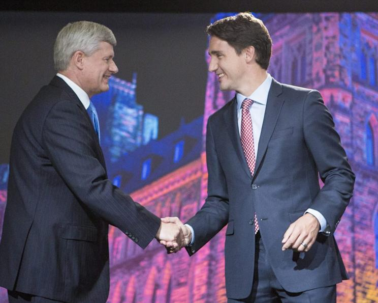 Conservative Party Leader Stephen Harper shakes hands with Liberal Leader Justin Trudeau before the start of the Globe and Mail Leaders Debate 2015. Photo from John Lehmann/The Globe and Mail via Getty Images