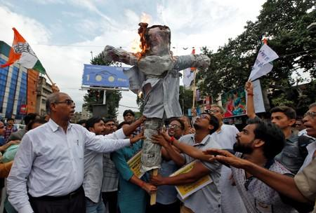 Supporters of India's main opposition Congress party burn an effigy depicting Home Minister Shah during a protest against the arrest of former Finance Minister Chidambaram, in Kolkata