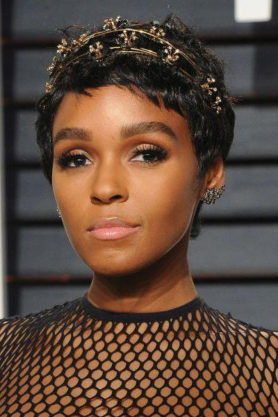 <p>Proving there's a million different ways to wear a pixie crop, Janelle Monae's bejewelled head band gives short hair an evening update.</p>