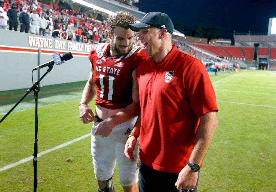 N.C. State head coach Dave Doeren laughs with Payton Wilson (11) after N.C. State's 31-20 victory over Duke at Carter-Finley Stadium in Raleigh, N.C., Saturday, Oct. 17, 2020.