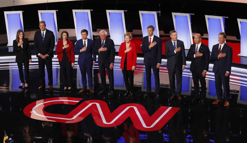 From left, Marianne Williamson, Rep. Tim Ryan, D-Ohio, Sen. Amy Klobuchar, D-Minn., South Bend Mayor Pete Buttigieg, Sen. Bernie Sanders, I-Vt., Sen. Elizabeth Warren, D-Mass., former Texas Rep. Beto O'Rourke, former Colorado Gov. John Hickenlooper, former Maryland Rep. John Delaney and Montana Gov. Steve Bullock take the stage for the first of two Democratic presidential primary debates hosted by CNN Tuesday, July 30, 2019, in the Fox Theatre in Detroit. | Paul Sancya—AP