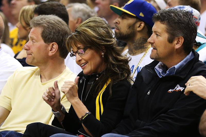 INDIANAPOLIS, IN - MAY 26:  Former Governor of Alaska Sarah Palin and her husband Todd attend Game Three of the Eastern Conference Finals between the Indiana Pacers and the Miami Heat at Bankers Life Fieldhouse on May 26, 2013 in Indianapolis, Indiana.  NOTE TO USER: User expressly acknowledges and agrees that, by downloading and or using this photograph, user is consenting to the terms and conditions of the Getty Images License Agreement.  (Photo by Andy Lyons/Getty Images)