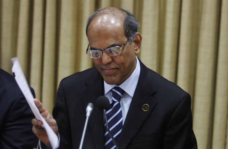 Reserve Bank of India (RBI) Governor Duvvuri Subbarao reads documents during a meeting with bankers at the RBI head office in Mumbai, India, Tuesday, April 17, 2012. The RBI slashed India's key interest rate by half a percentage point Tuesday, the first cut in three years and more than economists had expected. (AP Photo/Rafiq Maqbool)