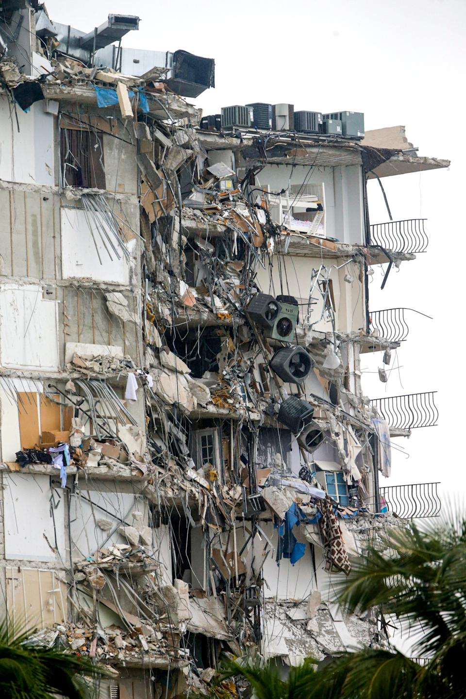 The 12-story condominium that partially collapsed early June 24 in Surfside, Fla.