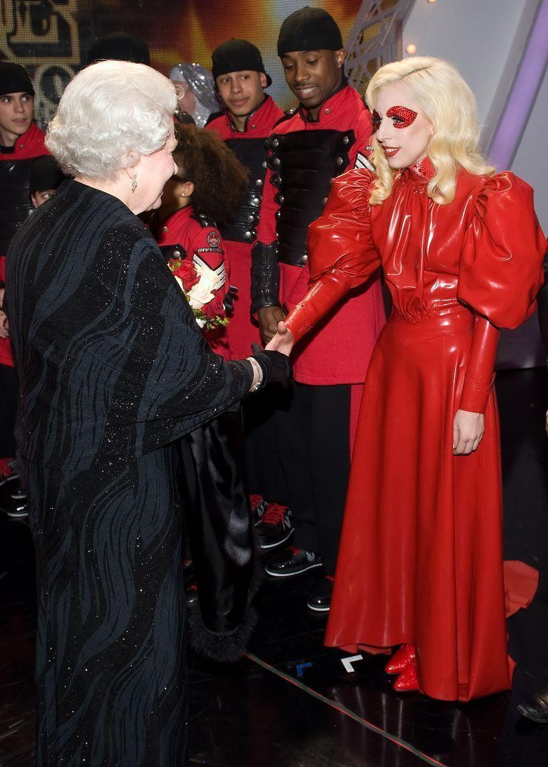 <p>At the peak of Lady Gaga's eye-catching outfits (the meat dress would appear the following year), the singer met Queen Elizabeth after the Royal Variety Performance wearing a cherry-red latex gown accompanied by matching red bedazzled eye makeup. </p>