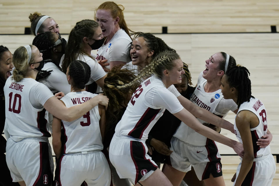 Stanford players celebrate their win over Louisville in a college basketball game in the Elite Eight round of the women's NCAA tournament at the Alamodome in San Antonio, Tuesday, March 30, 2021. (AP Photo/Eric Gay)