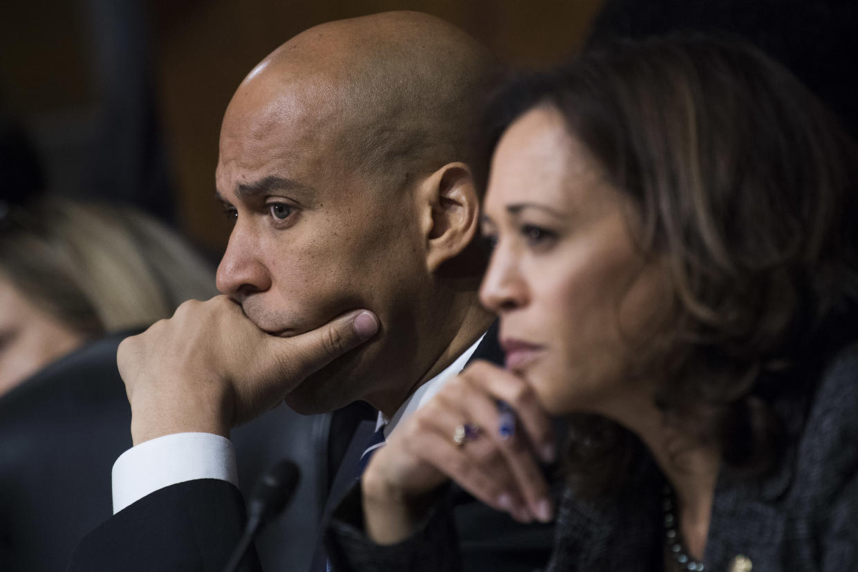 "<span class=""s1"">Cory Booker and fellow Democrat Kamala Harris of California listen to Christine Blasey Ford's testimony before the Senate Judiciary Committee. (Photo: Tom Williams/CQ Roll Call/Pool/Getty Images)</span>"