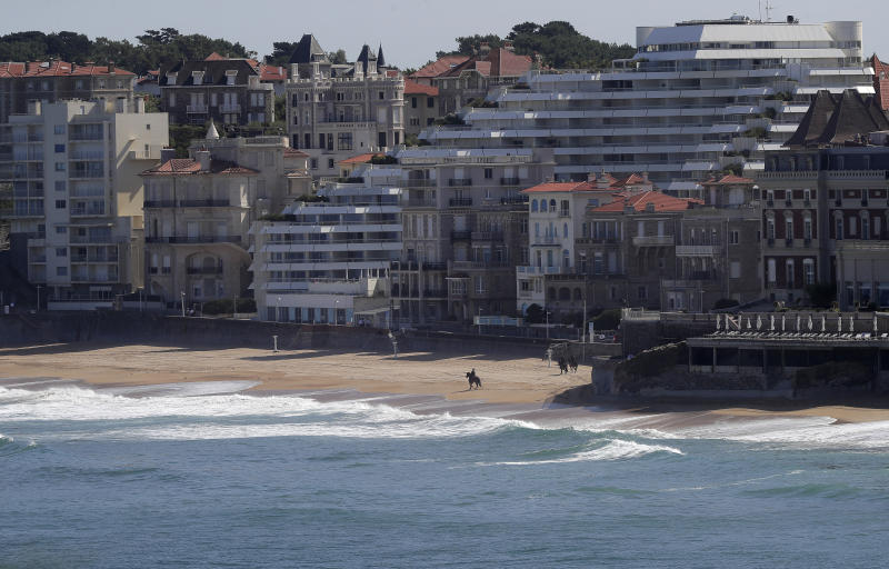 A mounted police officer rides along a deserted beach that falls inside the restricted area as security is stepped-up ahead of the G-7 summit in Biarritz, France Friday, Aug. 23, 2019. U.S. President Donald Trump will join host French President Emmanuel Macron and the leaders of Britain, Germany, Japan, Canada and Italy for the annual G-7 summit in the elegant resort town of Biarritz. (AP Photo/Markus Schreiber)