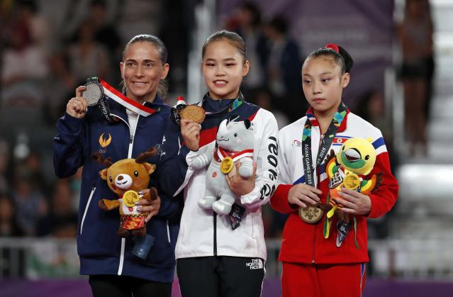 "<a class=""link rapid-noclick-resp"" href=""/olympics/rio-2016/a/1133551/"" data-ylk=""slk:Oksana Chusovitina"">Oksana Chusovitina</a> of Uzbekistan won a silver medal on vault at the Asian Games. At 43, Chusovitina is more than twice the age of gold medalist Yeo Seojeong of South Korea and bronze medalist Pyon Rye Yong of North Korea. (Reuters)"
