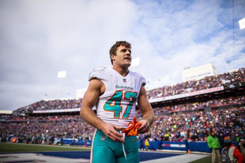 ORCHARD PARK, NY - DECEMBER 30: Kiko Alonso #47 of the Miami Dolphins is escorted from the field after being ejected during the third quarter against the Buffalo Bills at New Era Field on December 30, 2018 in Orchard Park, New York. Buffalo defeats Miami 42-17. (Photo by Brett Carlsen/Getty Images)