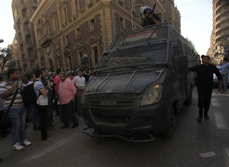 Riot police take position during a protest against a new law in Egypt that restricts demonstrations, in downtown Cairo November 26, 2013. REUTERS/Amr Abdallah Dalsh