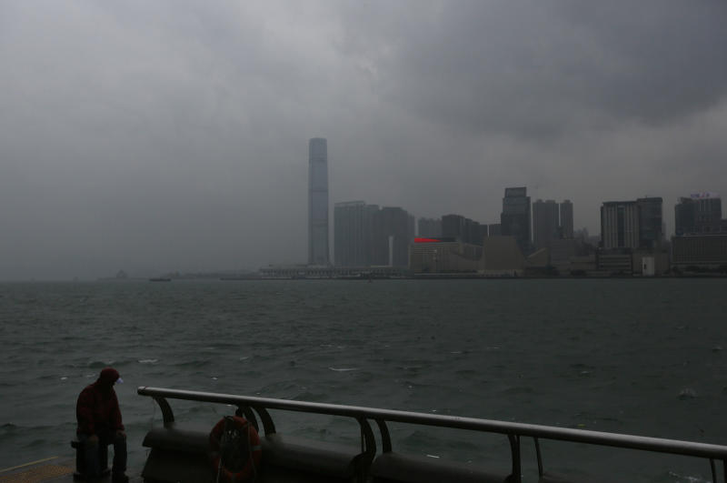 A man watches the wave at the waterfront in Hong Kong Sunday, Sept. 22, 2013. The year's most powerful typhoon had Hong Kong in its crosshairs on Sunday after sweeping past the Philippines and Taiwan and pummeling island communities with heavy rains and fierce winds. Typhoon Usagi was grinding westward and expected to make landfall close to Hong Kong late Sunday or early Monday. (AP Photo/Vincent Yu)