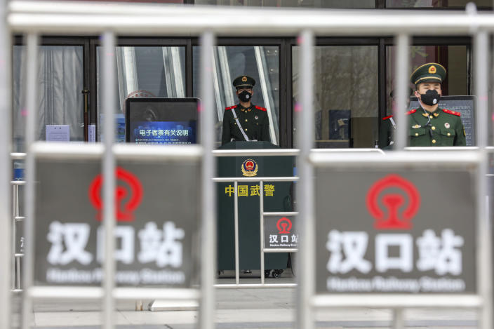 Chinese paramilitary police stand guard outside the closed Hankou Railway Station in Wuhan in central China's Hubei Province, Thursday, Jan. 23, 2020. China closed off a city of more than 11 million people Thursday in an unprecedented effort to try to contain a deadly new viral illness that has sickened hundreds and spread to other cities and countries amid the Lunar New Year travel rush. (Chinatopix via AP)