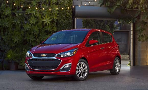 A red 2019 Chevrolet Spark, a very small hatchback.