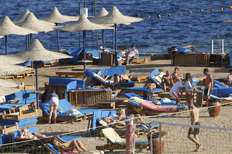 Foreign tourists enjoy the sunny weather at the beach of the Egyptian Red Sea resort town of Sharm el-Sheikh (AFP Photo/Mohammed Abed)