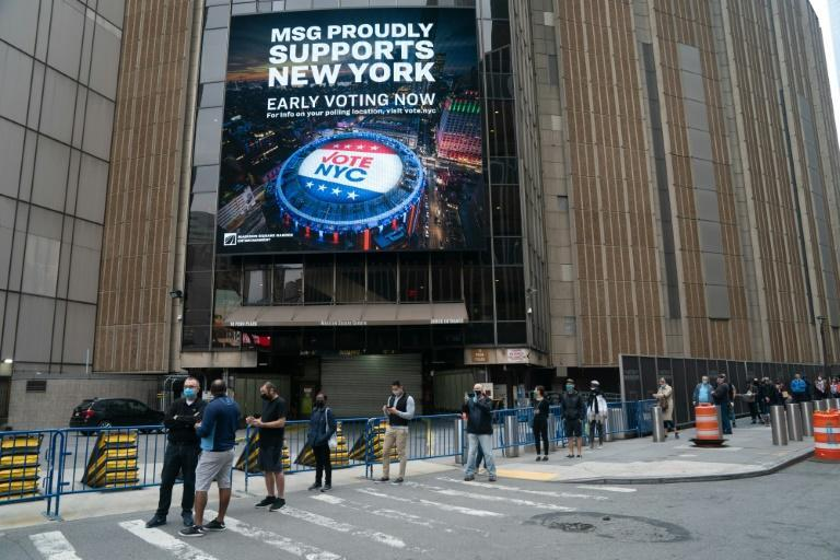 People line up outside Madison Square Garden in New York as early voting begins there on October 24, 2020