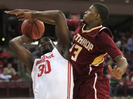 Winthrop's Larry Brown, right, fouls Ohio State's Evan Ravenel during the first half of an NCAA college basketball game, Tuesday, Dec. 18, 2012, in Columbus, Ohio. (AP Photo/Jay LaPrete)