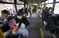 Left without subway service on Line 12 after Monday's collapse, commuters ride a bus on the south side of Mexico City, Thursday, May 6, 2021. At its farthest point, Line 12 carries commuters from the capital's still semi-rural south side to jobs across the city. Some 220,000 riders use Line 12 every day. (AP Photo/Marco Ugarte)