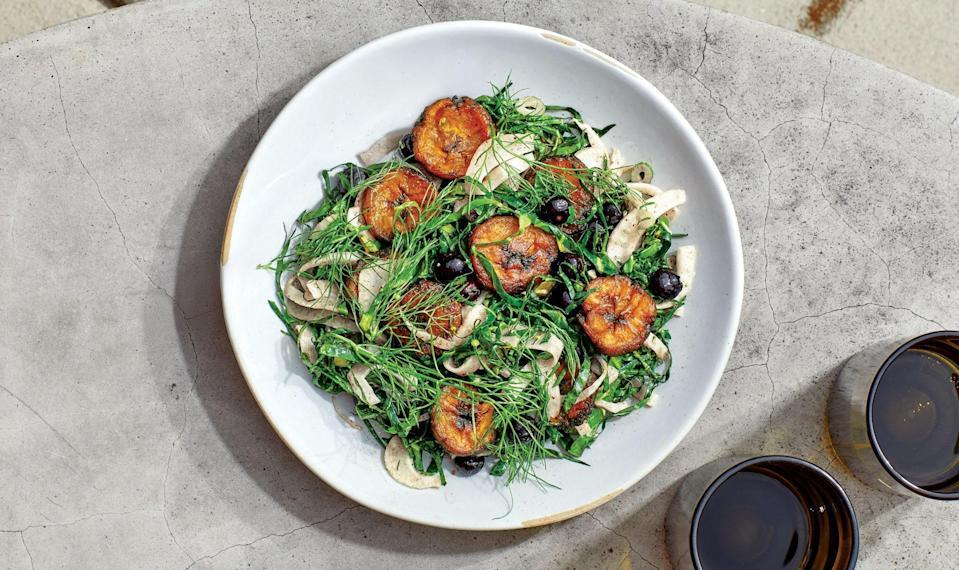 "Collard greens aren't just for braising; use them in this anytime-of-day salad, thinly sliced and tossed with a sweet and tangy dressing. This recipe is from chef Ashleigh Shanti at <a href=""https://www.benneoneagle.com/"" rel=""nofollow noopener"" target=""_blank"" data-ylk=""slk:Benne on Eagle"" class=""link rapid-noclick-resp"">Benne on Eagle</a> in Asheville, NC. <a href=""https://www.bonappetit.com/recipe/collard-greens-salad-with-fried-plantain-and-sumac?mbid=synd_yahoo_rss"" rel=""nofollow noopener"" target=""_blank"" data-ylk=""slk:See recipe."" class=""link rapid-noclick-resp"">See recipe.</a>"