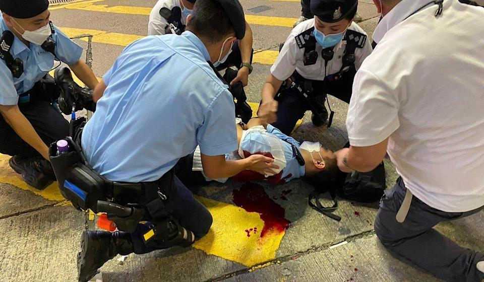 Police tend to the constable stabbed in Causeway Bay on Thursday. Photo: Handout