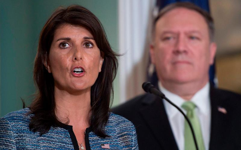 Nikki Haley, pictured beside Mike Pompeo, the secretary of state, announcing US withdrawal from the UN human rights council, on Tuesday in Washington DC - AFP