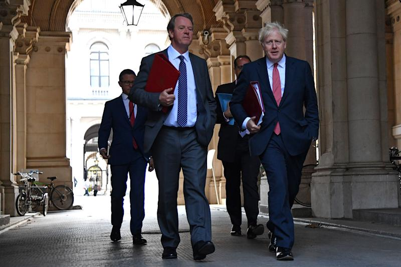 Britain's Prime Minister Boris Johnson (R) returns with Britain's Scotland Secretary Alister Jack (L) to Downing Street in central London on September 1, 2020 after holding the first weekly meeting of the cabinet since the summer recess in the Foreign and Commonwealth Office. - The UK Parliament returned to work on September 1 with the governing Conservative Party having taking a summer of hits in the polls bringing them level with the main opposition Labour Party amid a series of embarrassing U-turns and economic devastation wrought by the coronavirus pandemic. (Photo by JUSTIN TALLIS / AFP) (Photo by JUSTIN TALLIS/AFP via Getty Images)