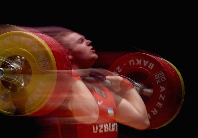 <p>Ivan Efremov of Uzbekistan competes in the Men's Weighlifting 105 kg finals during day three of Baku 2017 – 4th Islamic Solidarity Games at Weightlifting Arena. on May 17, 2017 in Baku, Azerbaijan. (Photo: Francois Nel/Getty Images) </p>