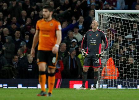 Soccer Football - Championship - Aston Villa vs Wolverhampton Wanderers - Villa Park, Birmingham, Britain - March 10, 2018 Wolverhampton Wanderers goalkeeper John Ruddy looks dejected after Aston Villa's third goal Action Images/Andrew Couldridge