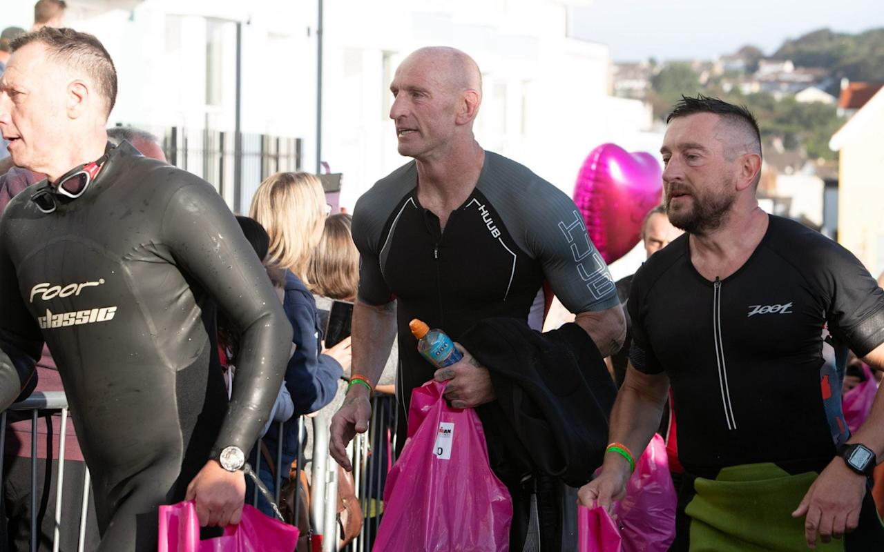 Gareth Thomas competing in an IronMan competition in Tenby, South Wales, after announcing he is HIV positive. Sept 15, 2019. - REX