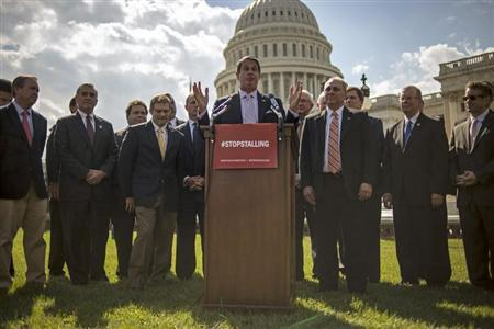 Sen. David Vitter speaks to reporters outside the Capitol about the government shutdown in Washington