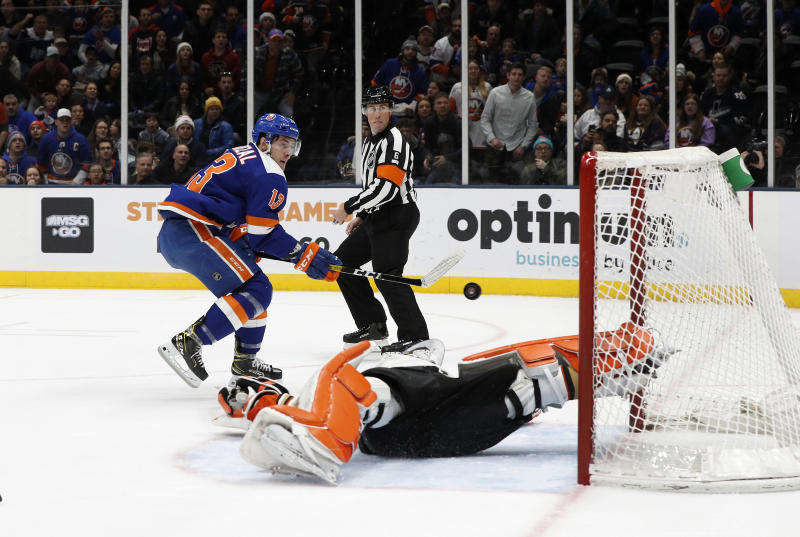 New York Islanders center Mathew Barzal (13) scores a goal on a breakaway against Anaheim Ducks goaltender John Gibson (36) during the second period of an NHL hockey game, Saturday, Dec. 21, 2019, in Uniondale, N.Y. (AP Photo/Jim McIsaac)