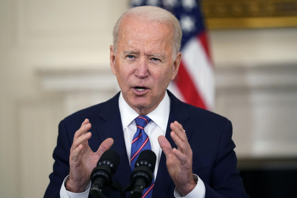 FILE - In this Friday, April 2, 2021 file photo, President Joe Biden speaks about the March jobs report in the State Dining Room of the White House, Friday, April 2, 2021, in Washington. Even though the federal government has spent tens of billions of dollars to close the digital divide, tens of millions of Americans still aren't online. The Biden administration has now broached a big number, $100 billion, in an effort to get all Americans connected. (AP Photo/Andrew Harnik, File)