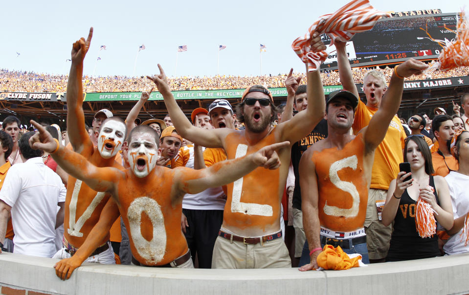 Tennessee fans yell in the first quarter of an NCAA college football game between the Tennessee Volunteers and the Florida Gators on Saturday, Sept. 15, 2012, in Knoxville, Tenn. (AP Photo/Wade Payne)