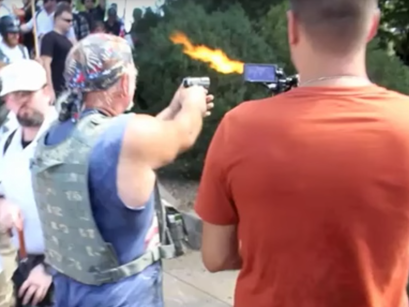 A man identified by police as Richard Wilson Preston points his gun at counter-protestors at a white supremacist rally in Virginia: YouTube