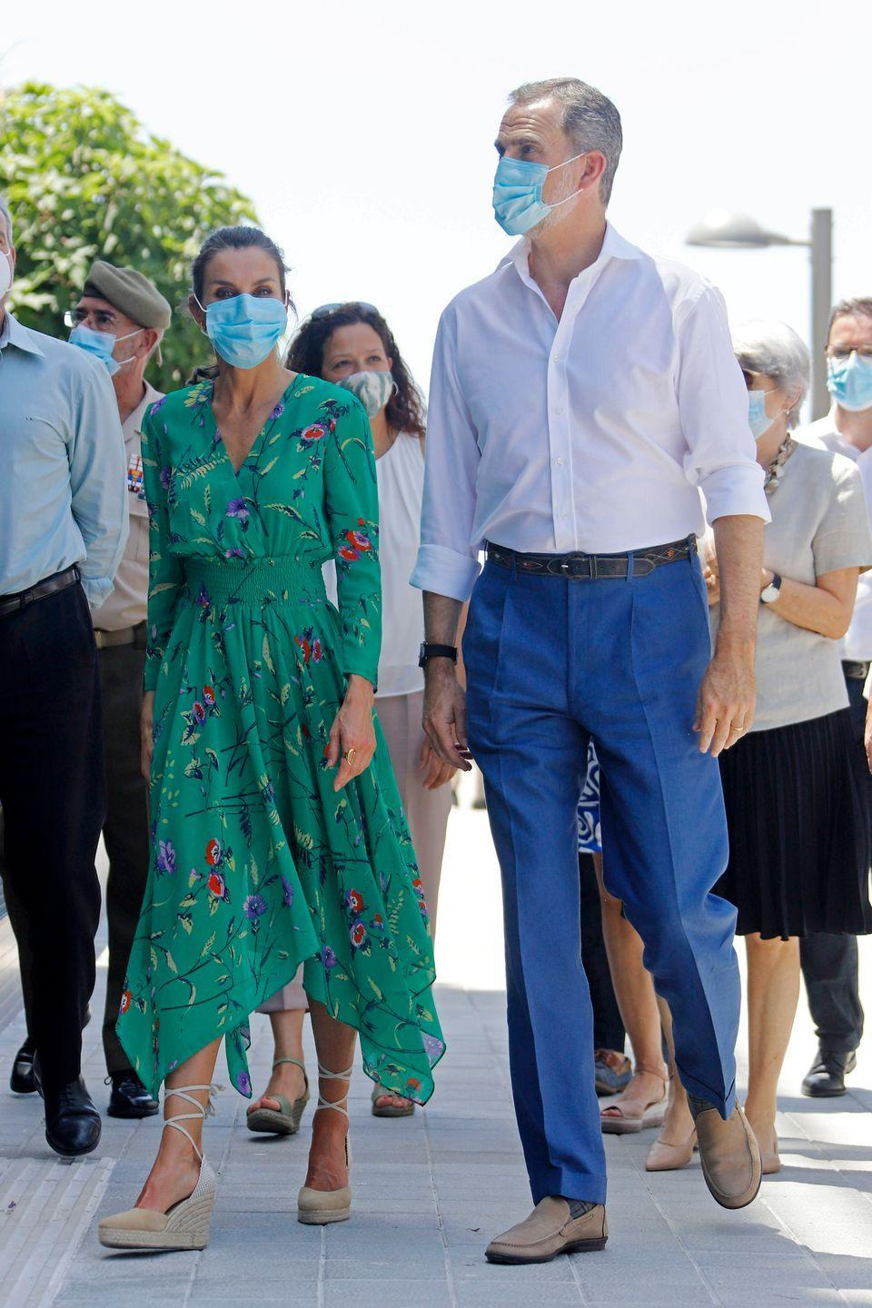 <p>King Felipe and Queen Letizia walked the promenade in Palma de Mallorca, Spain. The pair is on a royal tour of several Spanish Autonomous Communities, like Palma de Mallorca, to support and encourage economic, social, and cultural activity after the coronavirus outbreak. The Queen was a vision in a green floral dress from French label, Maje. She paired the look with tan espadrille wedges and a blue protective face mask. </p>