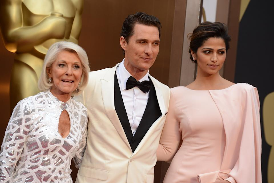 From left, Mary Kathlene McCabe, Matthew McConaughey and Camila Alves arrive at the Oscars on Sunday, March 2, 2014, at the Dolby Theatre in Los Angeles. (Photo by Jordan Strauss/Invision/AP)