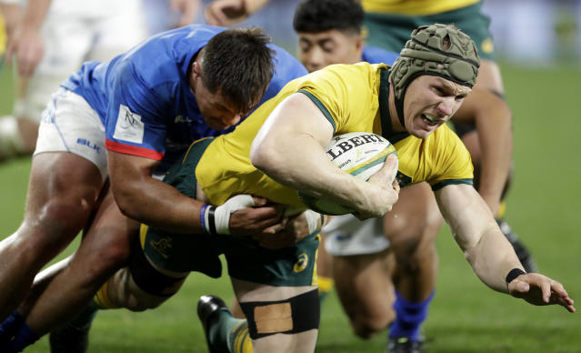 Australia's David Pocock, right, is tackled by Samoa's Jordan Lay during their rugby union test match in Sydney, Saturday, Sept. 7, 2019. (AP Photo/Rick Rycroft)