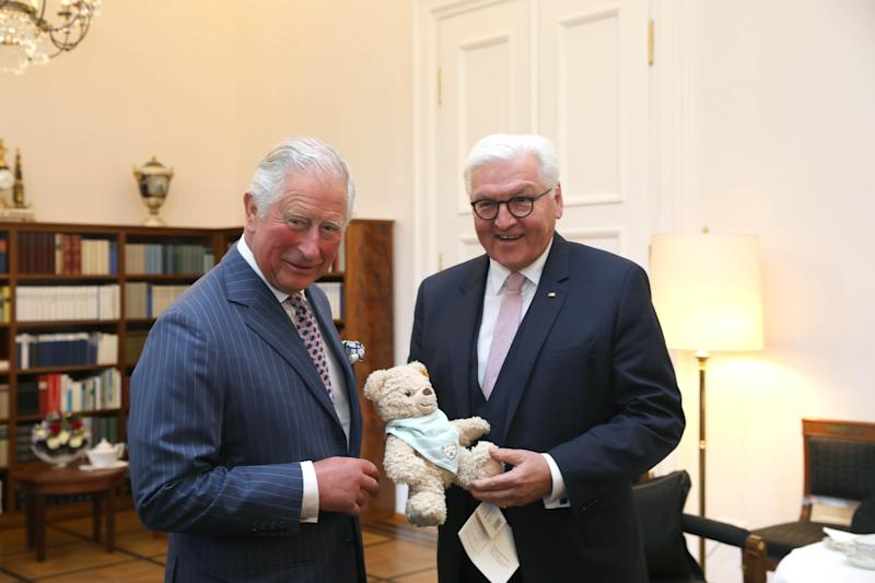The Prince of Wales is handed a soft toy for his new grandson by German President Frank-Walter Steinmeier during a meeting in Berlin [Photo: PA]