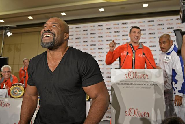 Former heavyweight world champion Shannon Briggs of the United States, left, shows up at a press conference of boxer Wladimir Klitschko of Ukraine, right, during a press conference ahead of Klitschko's IBF, IBO, WBO and WBA heavyweight title bout against challenger Alex Leapai from Australia-Samoa in Duesseldorf, Germany, April 22, 2014. Briggs demanded a title fight against Klitschko in the US. (AP Photo/Martin Meissner)