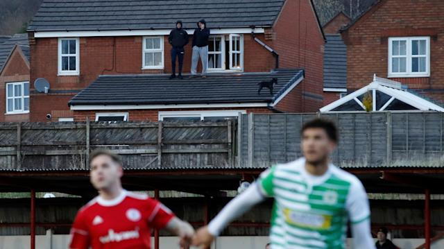 "Soccer Football - League Two - Accrington Stanley vs Yeovil Town - Wham Stadium, Accrington, Britain - April 17, 2018 General view of fans and a dog watching the match from the roof of a nearby house Action Images/Carl Recine EDITORIAL USE ONLY. No use with unauthorized audio, video, data, fixture lists, club/league logos or ""live"" services. Online in-match use limited to 75 images, no video emulation. No use in betting, games or single club/league/player publications. Please contact your account representative for further details."