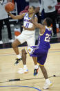 DePaul's Charlie Moore (11) drives to the basket past Western Illinois' Marcus Watson Jr. during the second half of an NCAA college basketball game Wednesday, Dec. 23, 2020, in Chicago. (AP Photo/Charles Rex Arbogast)