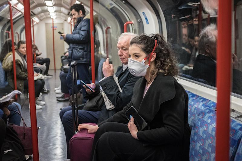 A woman seen on a tube wearing a face mask. A total of nine people in the UK are now being treated for COVID-19, the disease caused by the coronavirus. Doctors have warned that the London Underground could be a hotbed for the coronavirus. (Photo by S.C. Leung / SOPA Images/Sipa USA) (Photo: SIPA USA/PA Images)