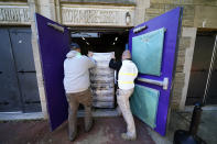 Chester County, Pa., workers transport mail-in and absentee ballots to be processed at West Chester University, Wednesday, Nov. 4, 2020, in West Chester. (AP Photo/Matt Slocum)
